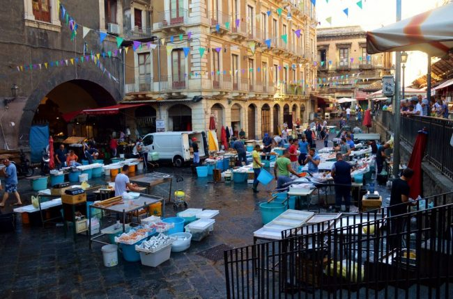 The Fish Market in Catania buzzes with activity in the morning.