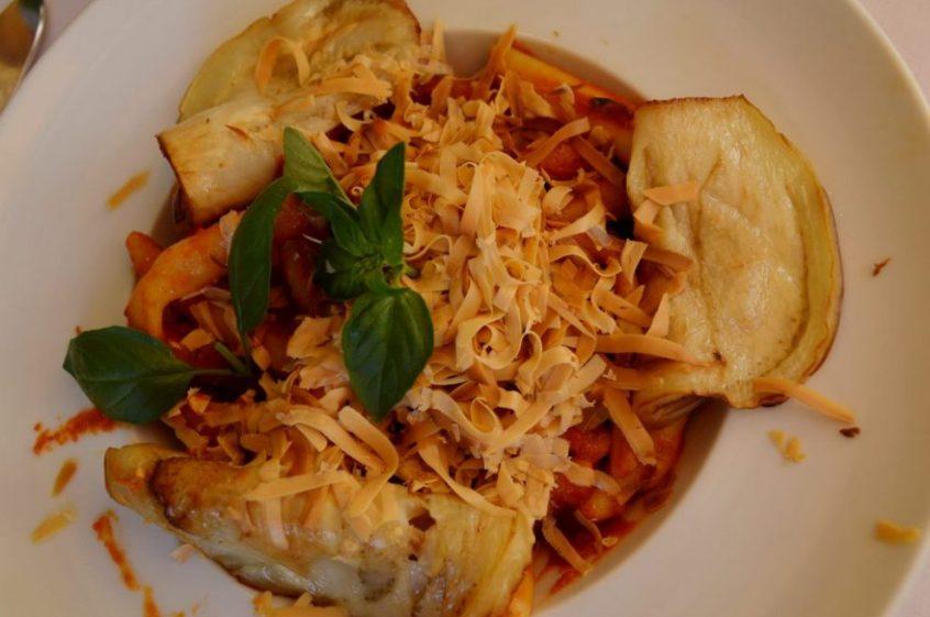 Macaroni with eggplant and scamorza cheese shavings Red & White Hostaria Taormina