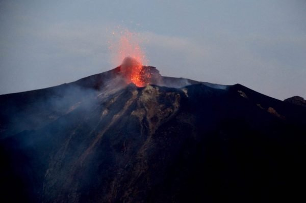 The volcano of Stromboli spewing ash - visit island off italy