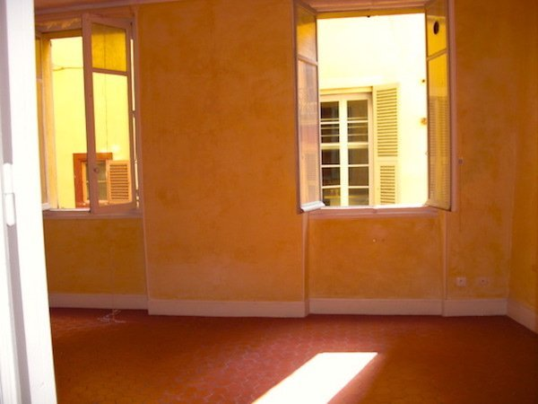 Yellow-washed walls everywhere and red tommette tiles!