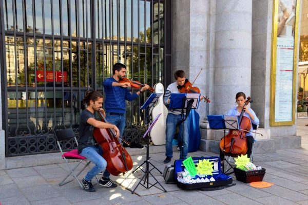 Musicians playing music near the Teatro Real