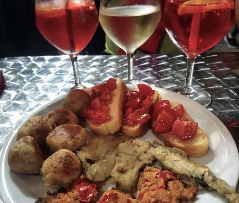 Traditional Italian Apero of Aperol Spritz and local delicacies