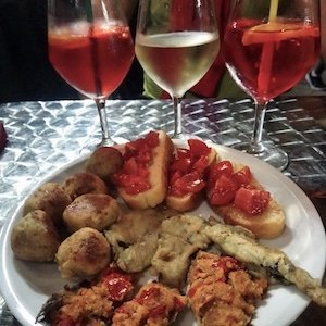 Aperatif with wine and local Italian bites