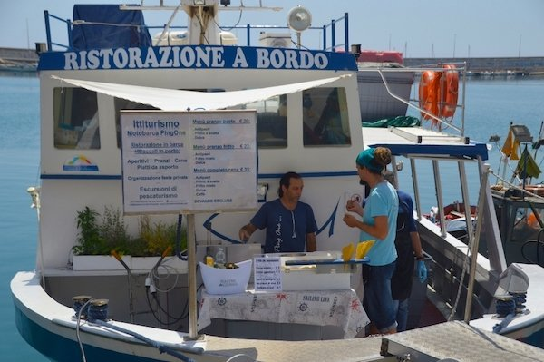 Dine on a fishing boat in the port of Oneglia in Imperia, Italy