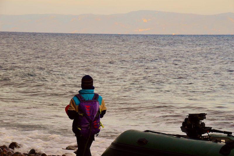 Young refugee boy gazing toward Turkey