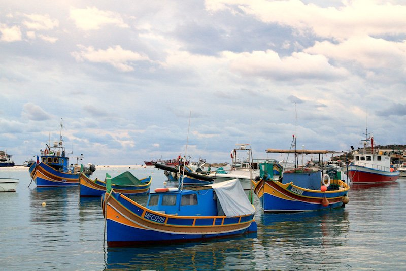 Marsaxlokk-Fishing-Boats-Malta-Reflections-Enroute