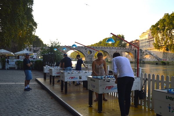 Foosball tables in front of the tiber river