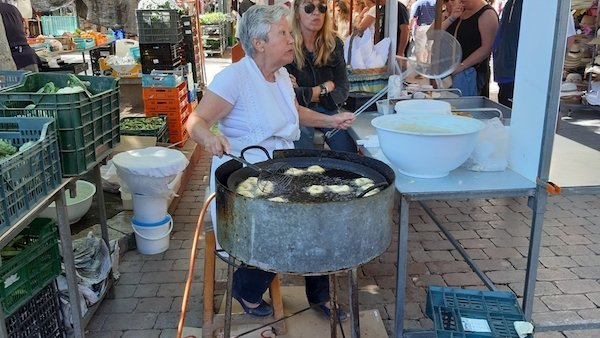 Local donuts being fried at the market in Alcudia