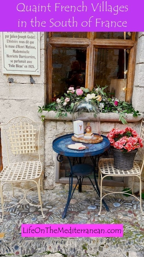 Table and chairs outside a shop in St Paul de Vence