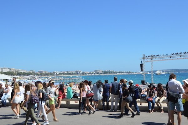 Strolling the Croisette in Cannes during the busy Cannes Film Festival.