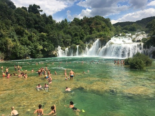 Krka Waterfalls with lots of people in high season.