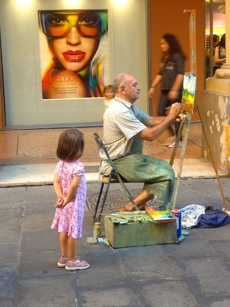 Street artists come out on Via dell'Independenza in Bologna