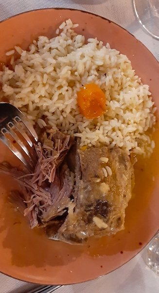 Typical Naxos food of Roasted lamb with lemon rice